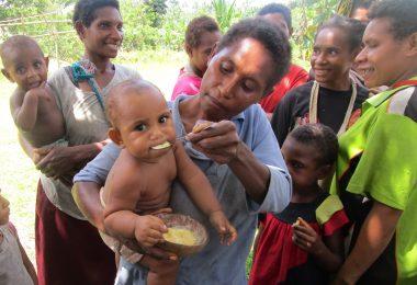 Child in Suabi Village, PNG, enjoying nutritious corn porridge (Russ Stephenson)