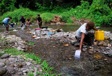 Fetching water from a stream in PNG