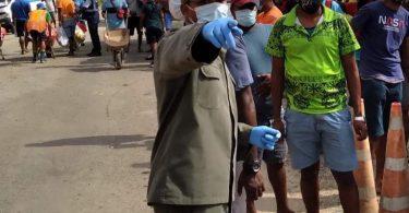 Fiji military directing people at a COVID-19 testing centre in the Lami-Suva-Nausori containment area