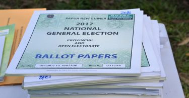 Photograph of a pile of books of ballot papers in the 2017 elections in Papua New Guinea.