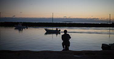 A man fishing in Nuku'alofa, Tonga (Conor Ashleigh-DFAT-Flickr)