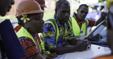 A woman at work in PNG (IFC)