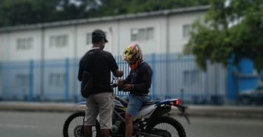 Julieto Soares selling pulsa on a street in Colmera, Dili (Aashna Jamal)